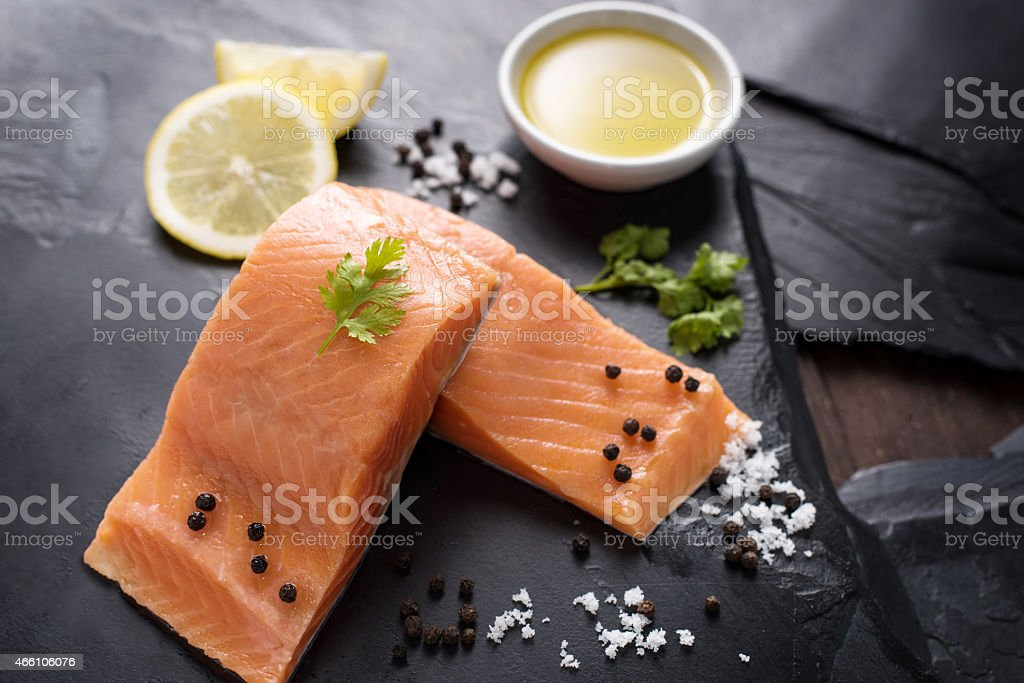Fresh salmon with spices, cooking concept stock photo
