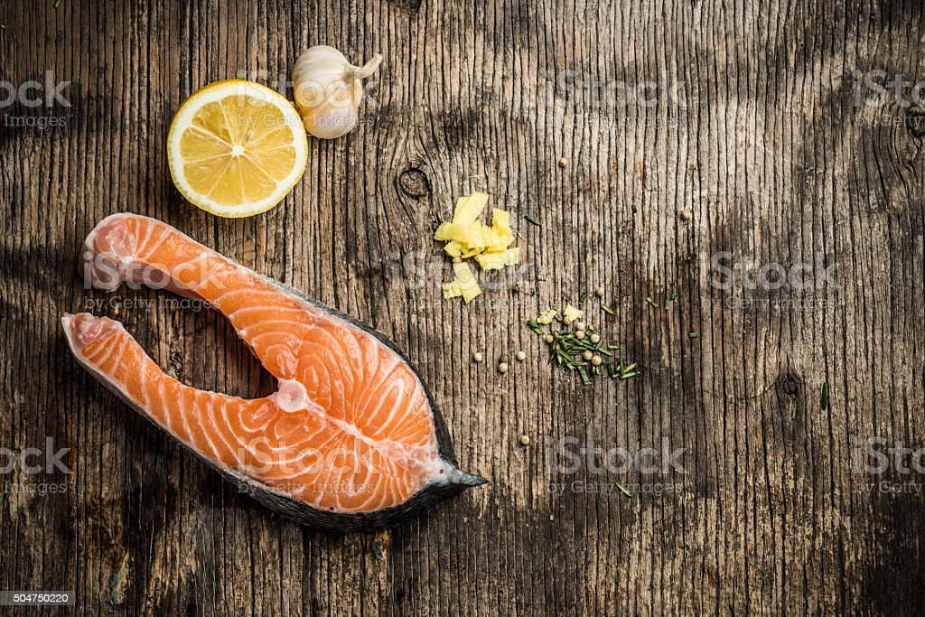 Fresh salmon with spices stock photo