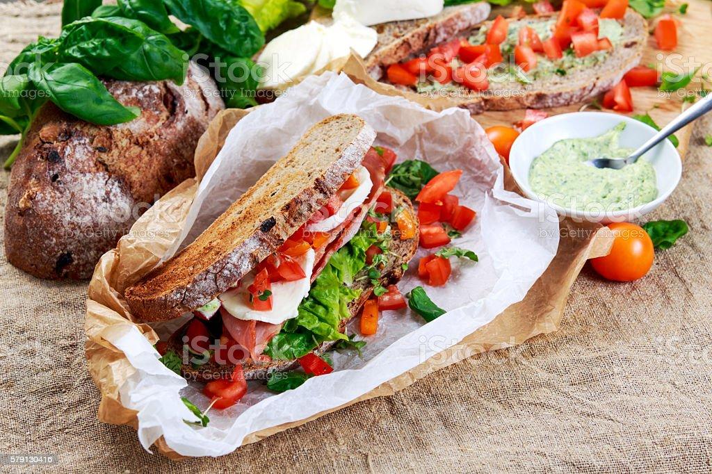 Fresh Sandwich with Bacon Lettuce Tomato and Mozzarella stock photo
