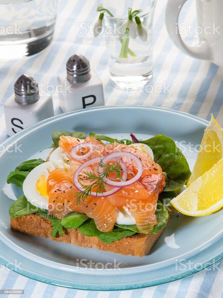 Fresh sandwich with gravlax salmon, egg and salad royalty-free stock photo