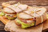 Fresh sandwich with ham cheese and lettuce