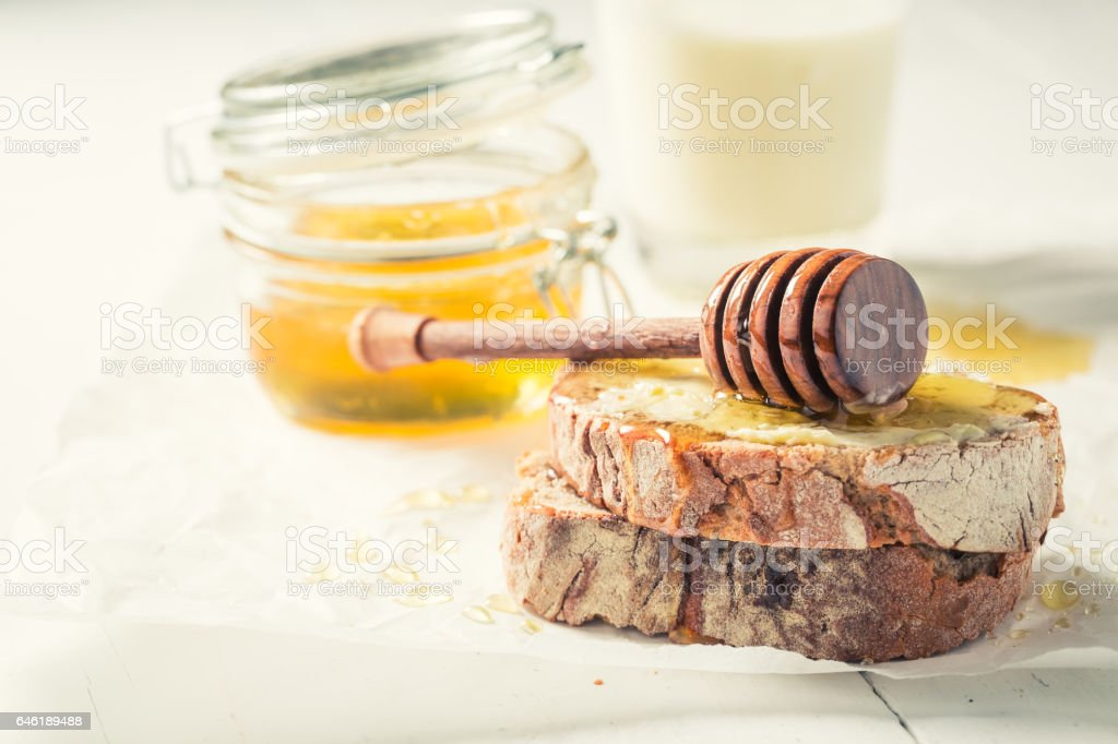 Fresh sandwich with honey for breakfast with milk stock photo