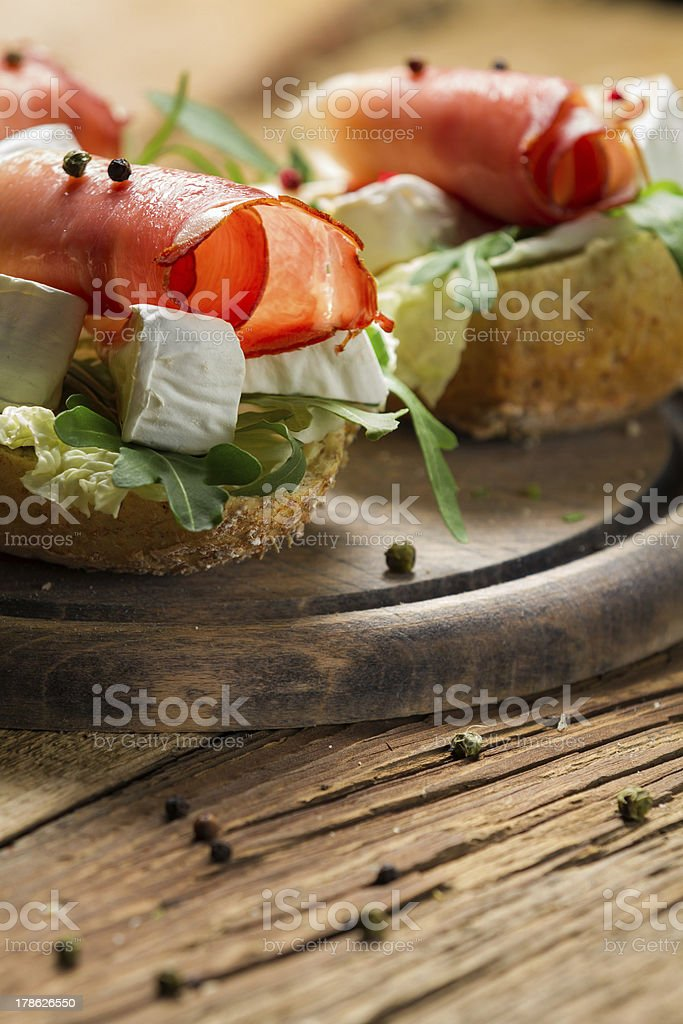 Fresh sandwiches on a old wooden cutting board background 6 royalty-free stock photo