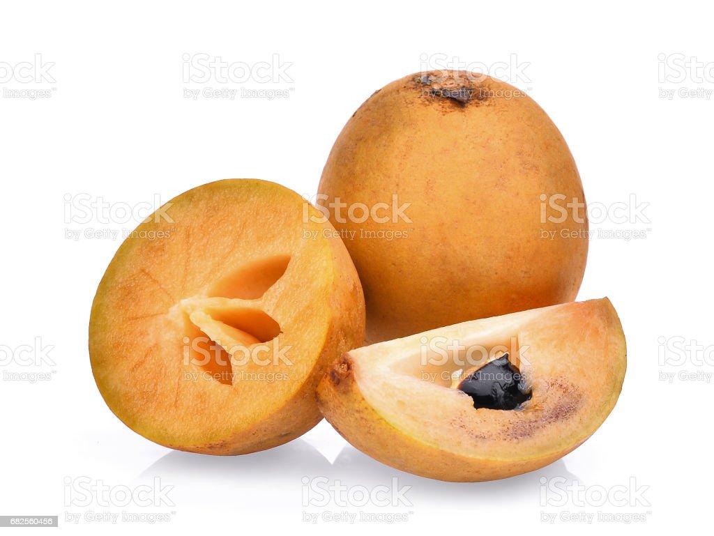 fresh sapodilla fruit isolated on white background stock photo