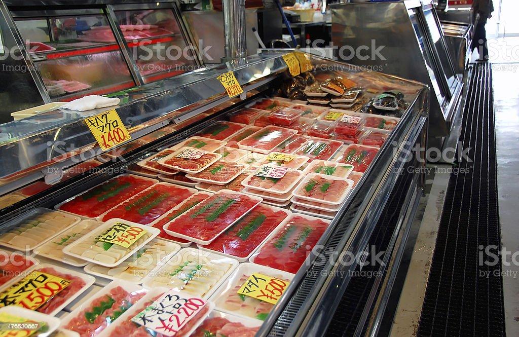Fresh sashimi selling in fish market royalty-free stock photo