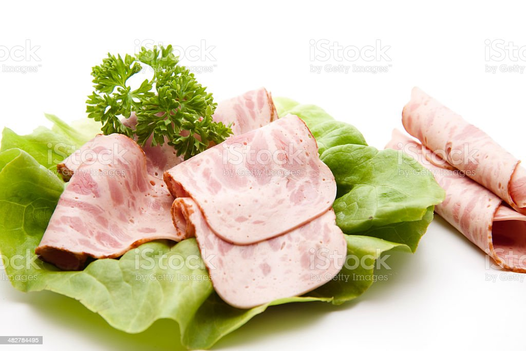 Fresh sausage with parsley and salad leaf stock photo