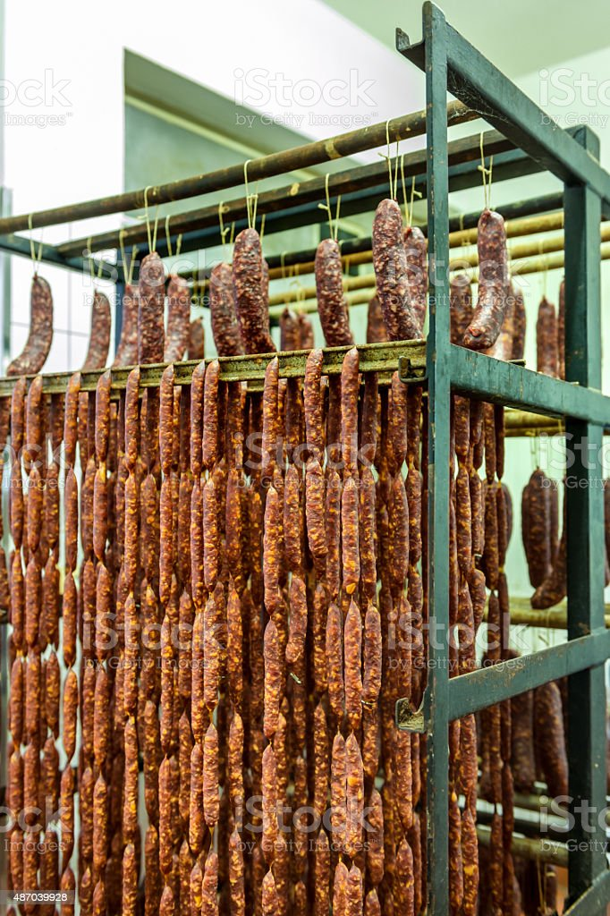 fresh sausages on rack stock photo