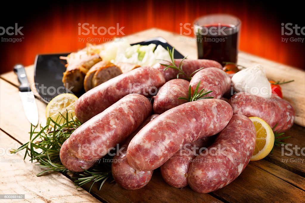 fresh sausages with various vegetables stock photo