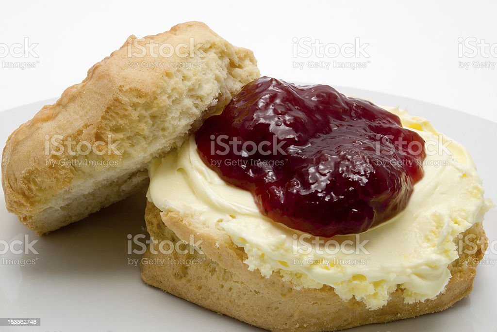 fresh scone with jam and cream royalty-free stock photo
