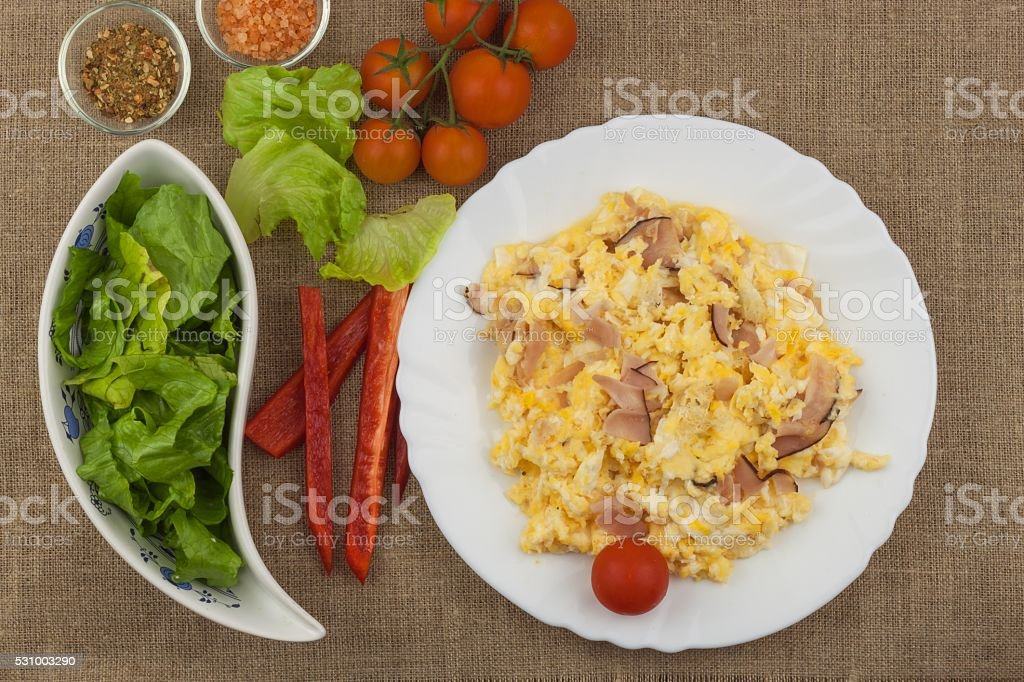 Fresh scrambled eggs with bacon and vegetables stock photo