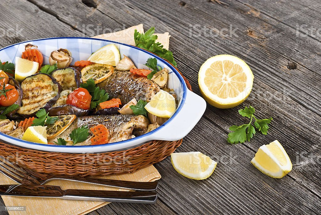 fresh seabass baked with vegetables royalty-free stock photo