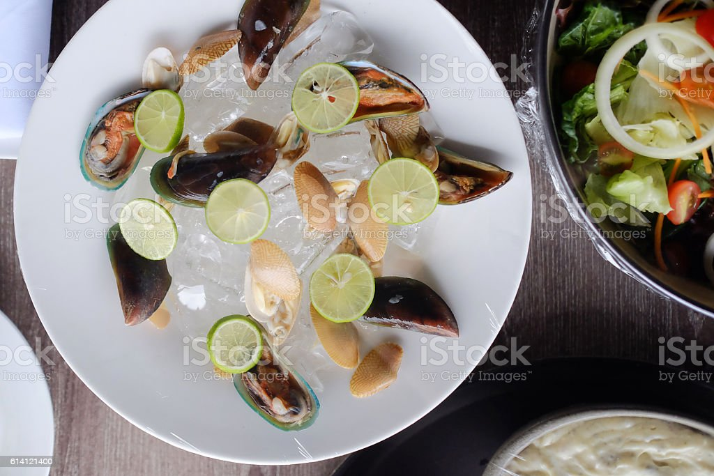 Fresh seafood with lime stock photo