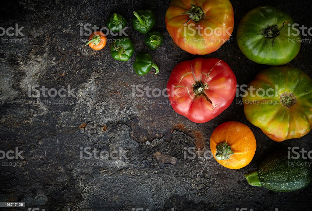 Fresh seasonal vegetables on dark rusty surface stock photo
