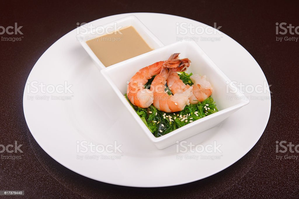 fresh seaweed salad with shrimps stock photo