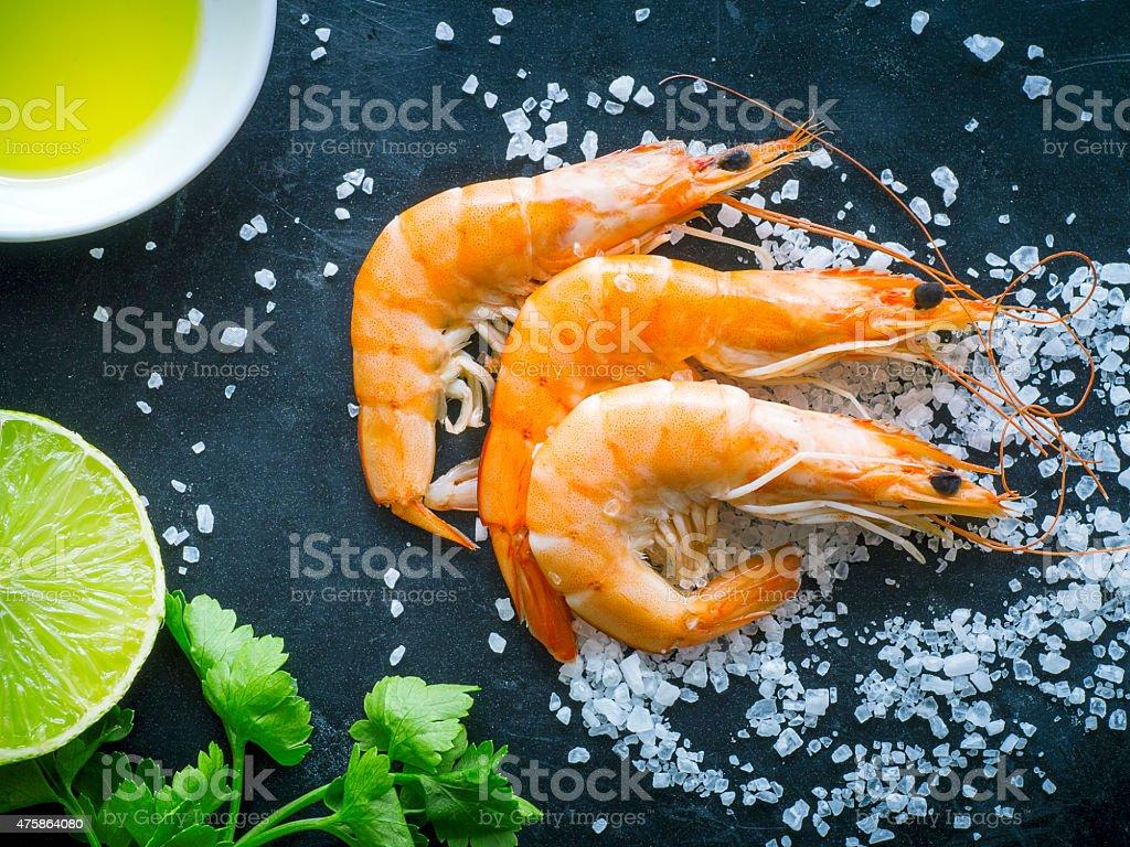 Fresh shrimps on dark background stock photo
