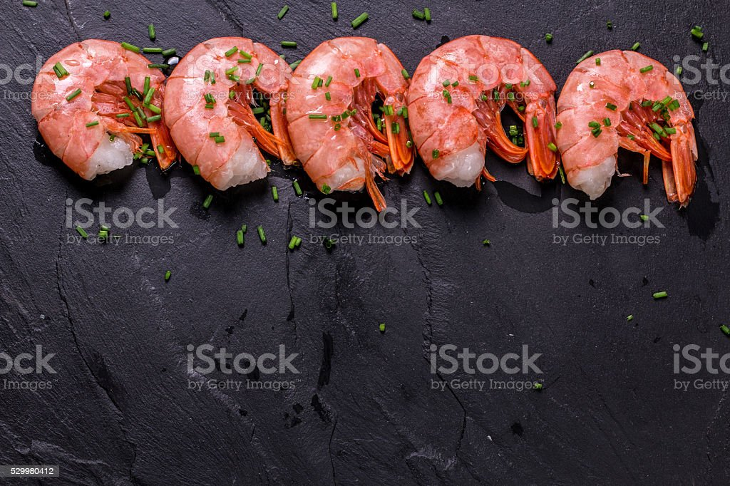 fresh shrimps served with onion and lime stock photo