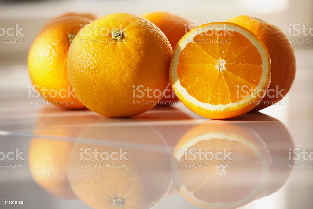 Fresh sliced and whole organic oranges. stock photo