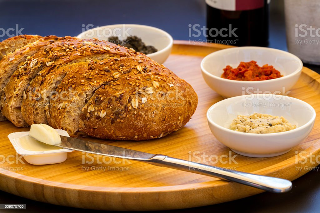 Fresh sliced country style whole grain bread stock photo