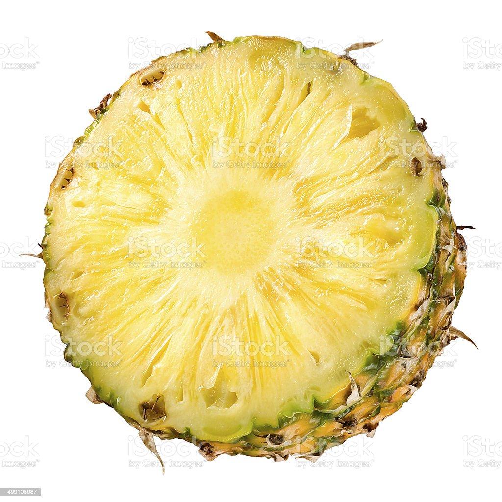 Fresh sliced pineapple. Half of fruit on white stock photo