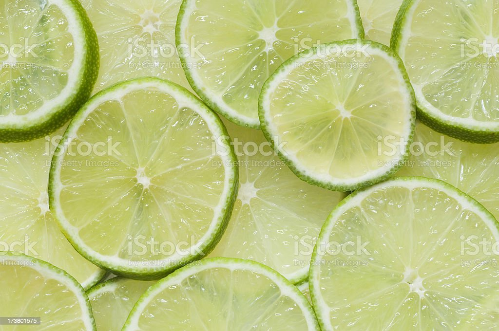 Fresh slices of lime stock photo