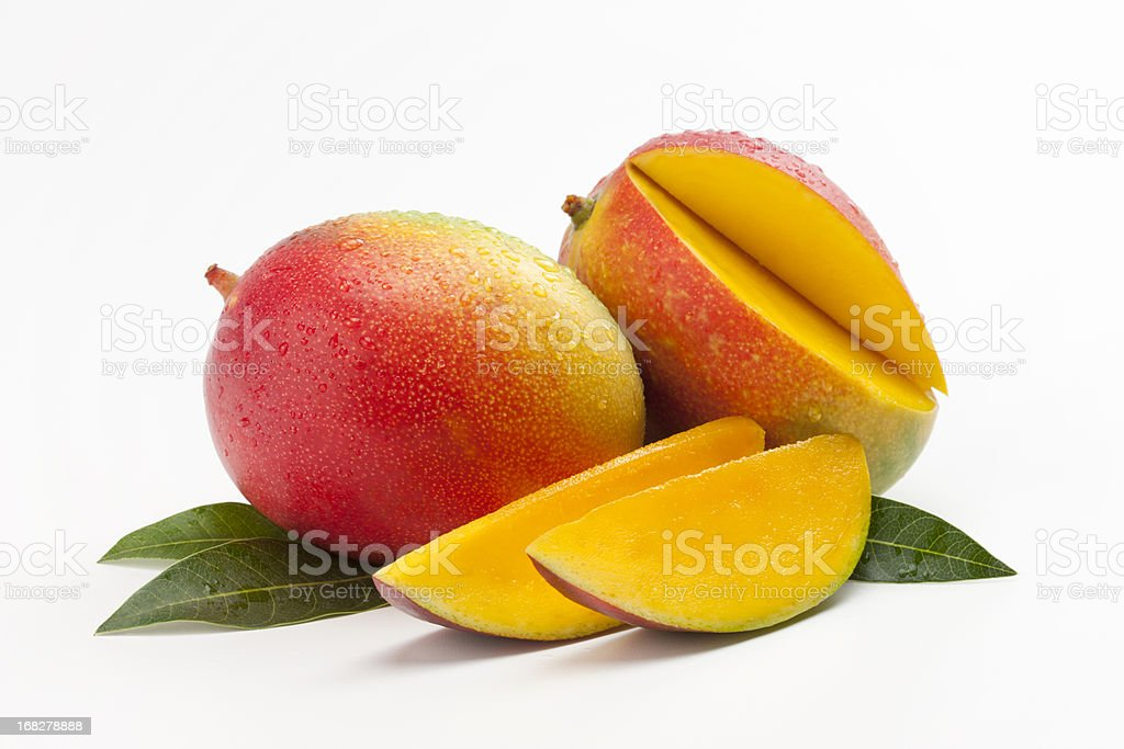 Fresh Slices of Mango on a Bed of Leaves stock photo