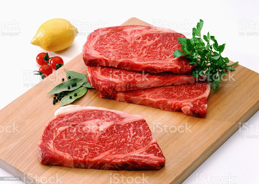 Fresh  Slices of Raw steak,beef on cutting board stock photo