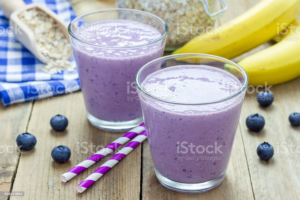 Fresh smoothie with blueberry, banana, oats, almond milk and yogurt stock photo