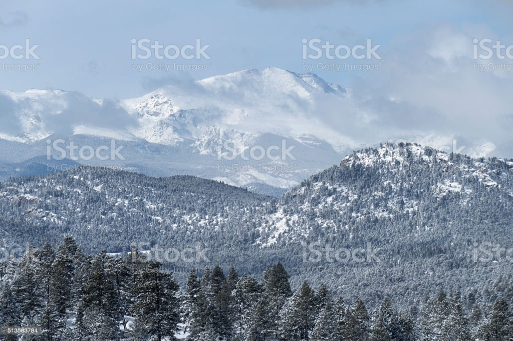 Fresh snow covered Mount Evans and pine forests Colorado stock photo