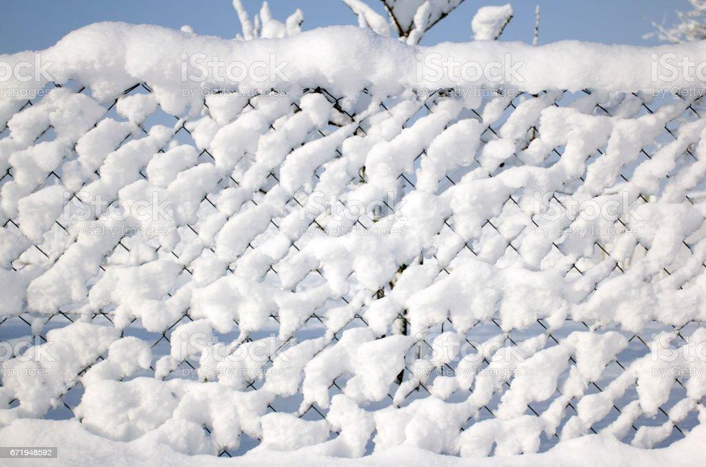 fresh snow on fence stock photo