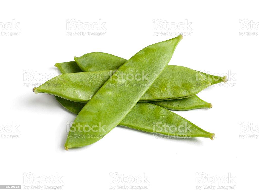Fresh snow peas in a pile on white background stock photo