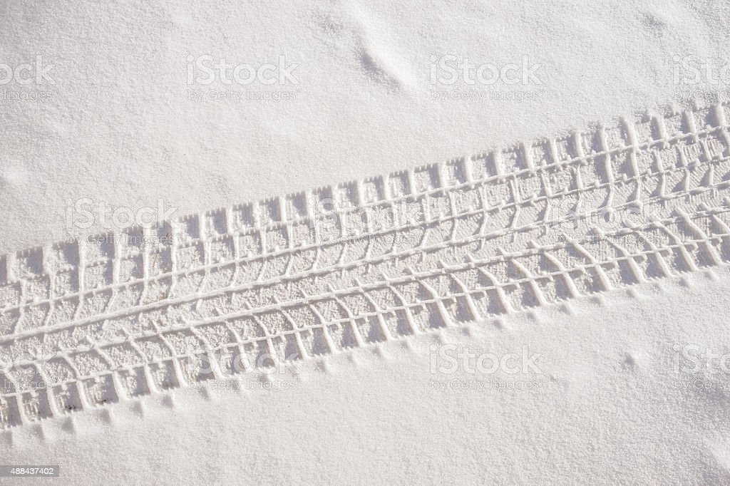 Fresh snow sedan tire track stock photo