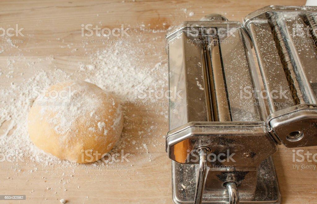fresh spaghetti pasta ingredients and press machine stock photo