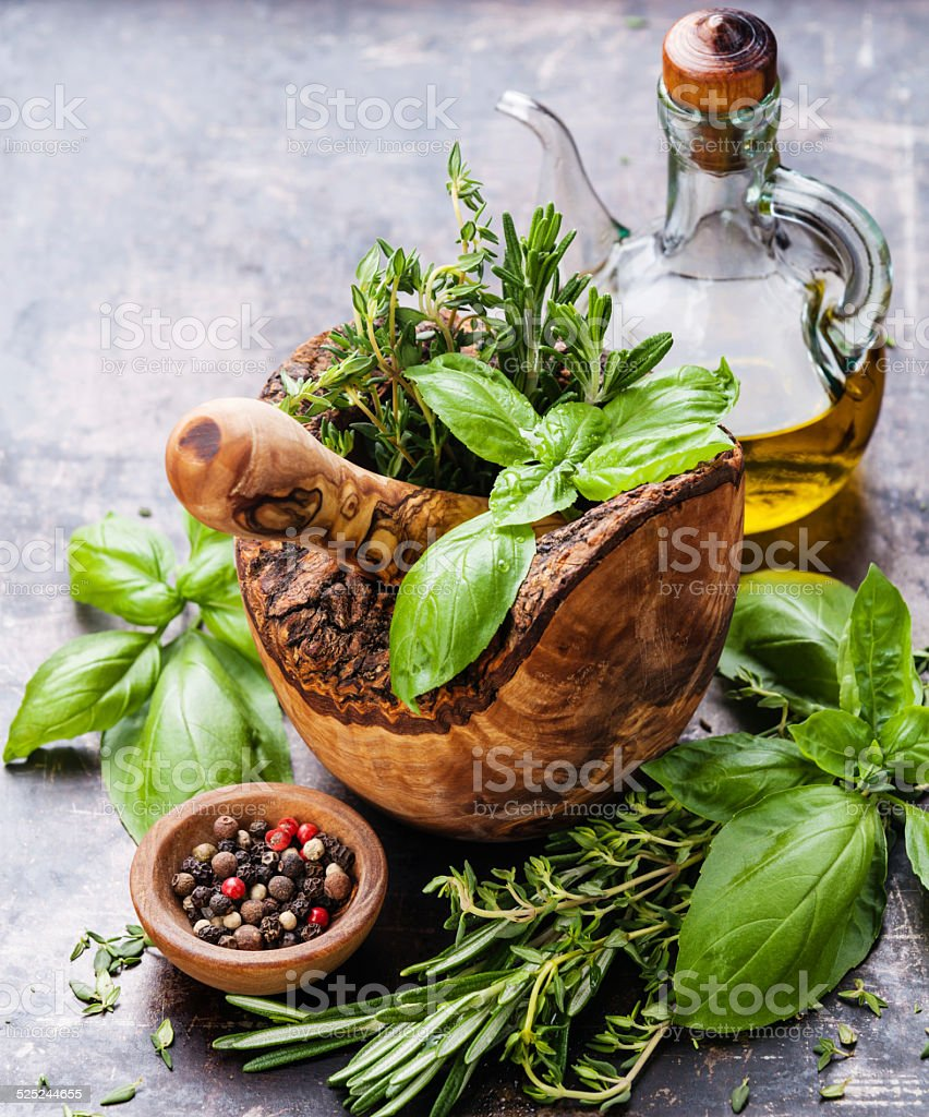 Fresh spicy herbs in Mortar stock photo