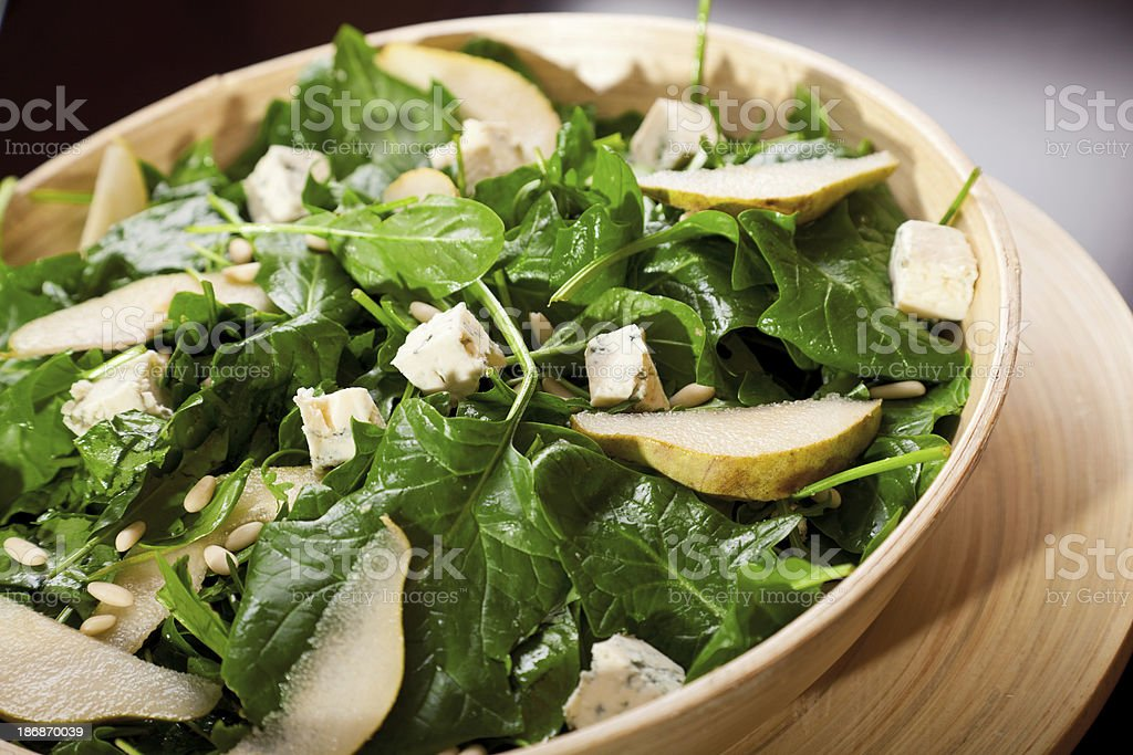 Fresh spinach salad with blue cheese, pears and honey stock photo