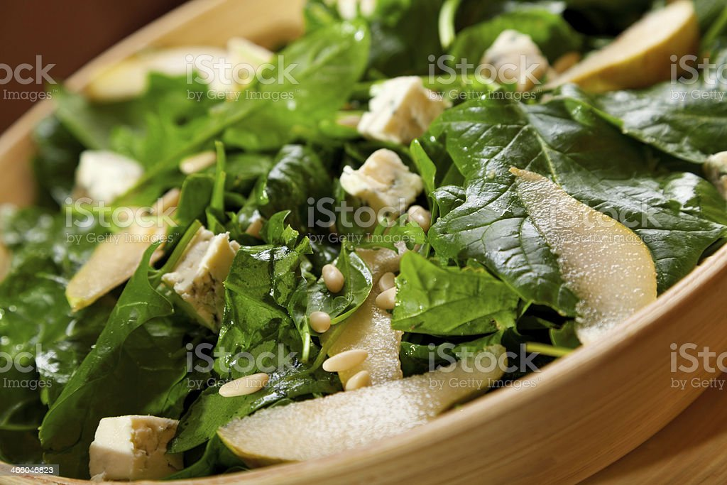 Fresh spinach salad with blue cheese, pears and honey royalty-free stock photo