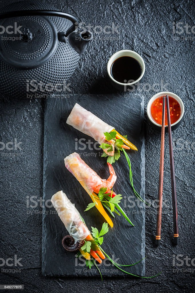 Fresh spring rolls with soy sauce stock photo