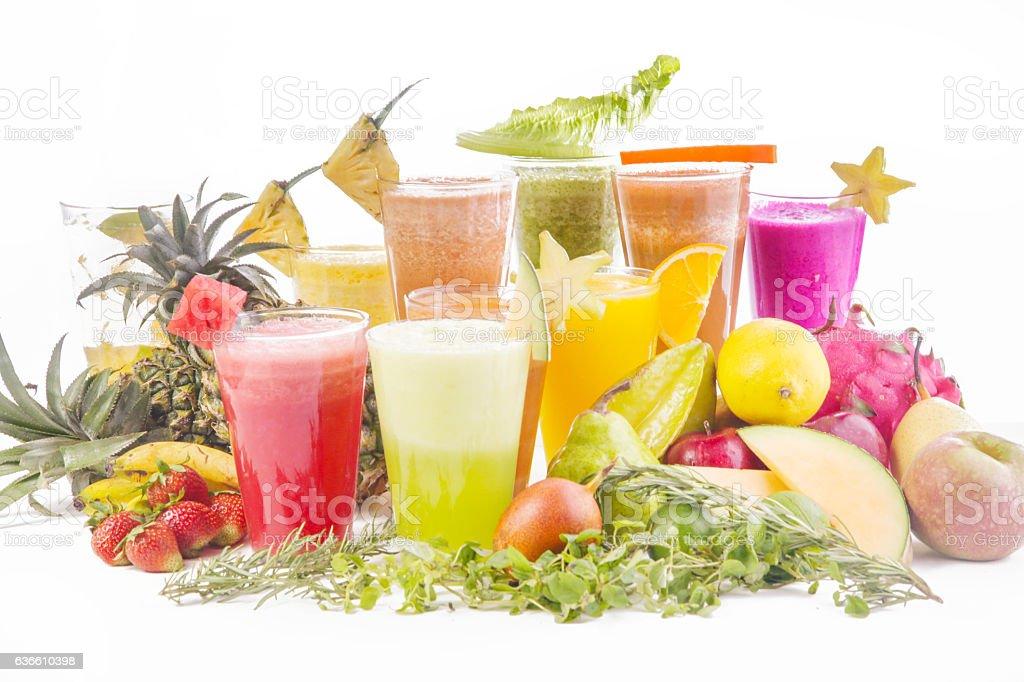 Fresh squeezed juice, many glasses on white background, stock photo