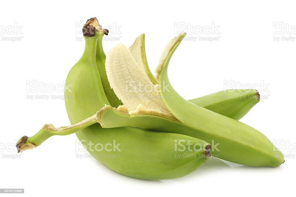 fresh still unripe bananas and a peeled one stock photo