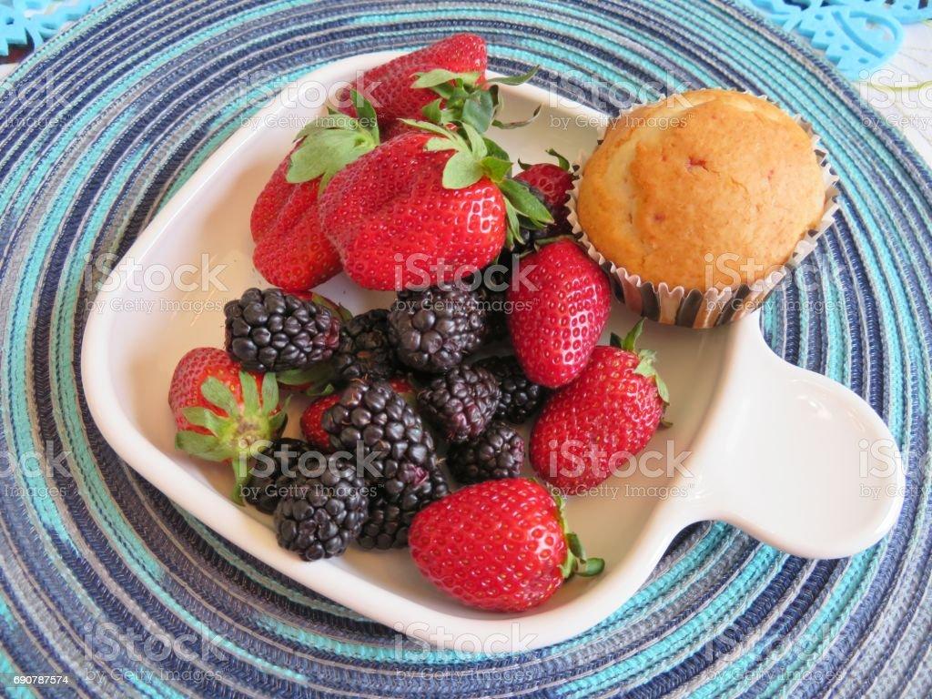 Fresh strawberries and blackberries stock photo