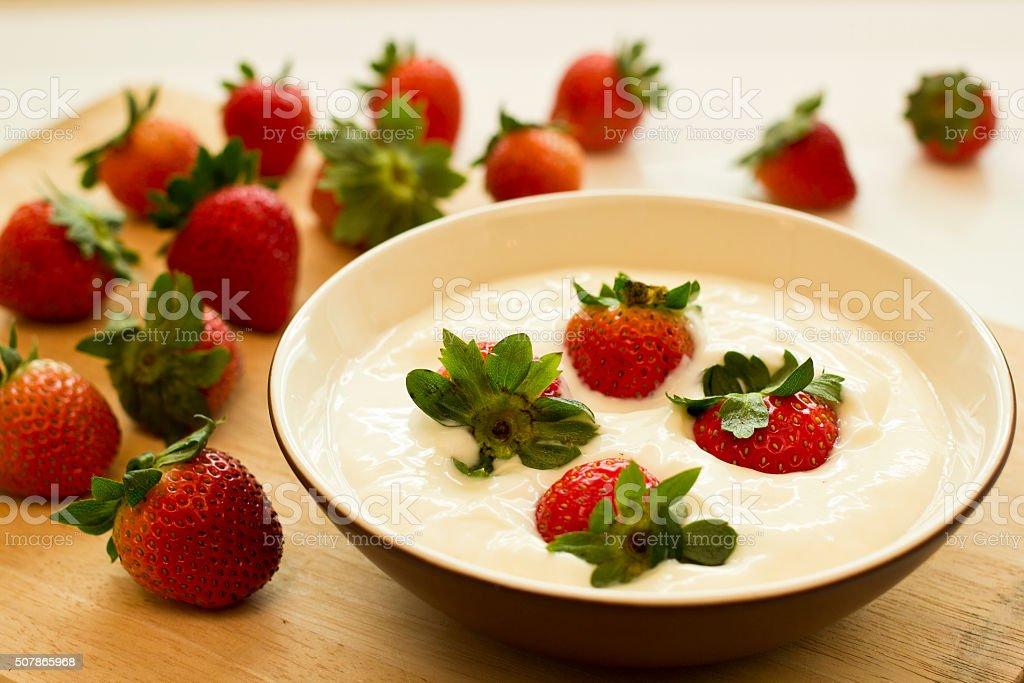 Fresh strawberries and yogurt stock photo