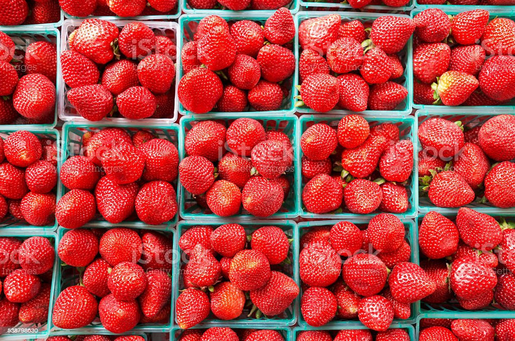 Fresh Strawberries for sale in farmers market stock photo