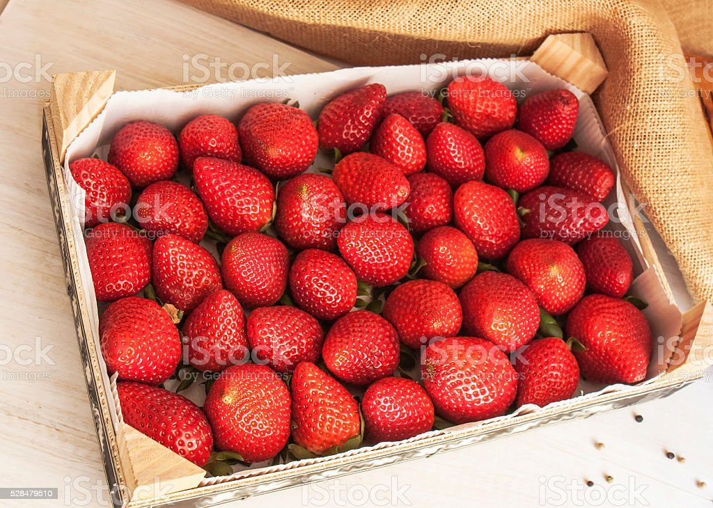 fresh strawberries in a wooden box stock photo