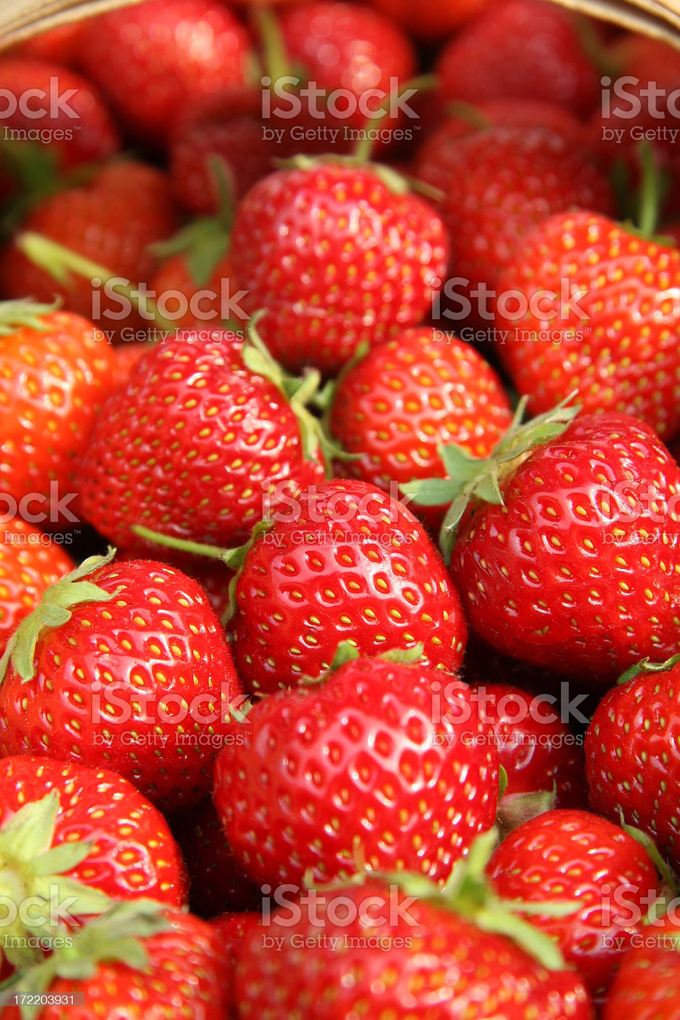Fresh strawberries in basket royalty-free stock photo