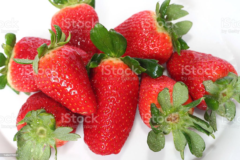 'Fresh strawberries in dish, isolated' royalty-free stock photo