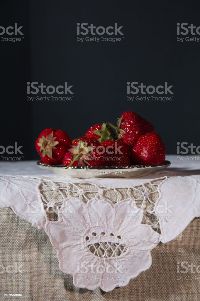 Fresh strawberries on a silver saucer stock photo