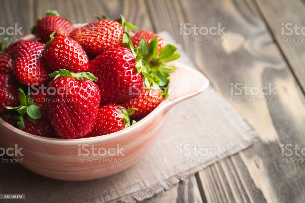 Fresh strawberries on a table stock photo