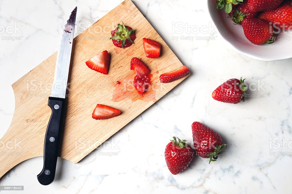 fresh strawberries on cutting board stock photo