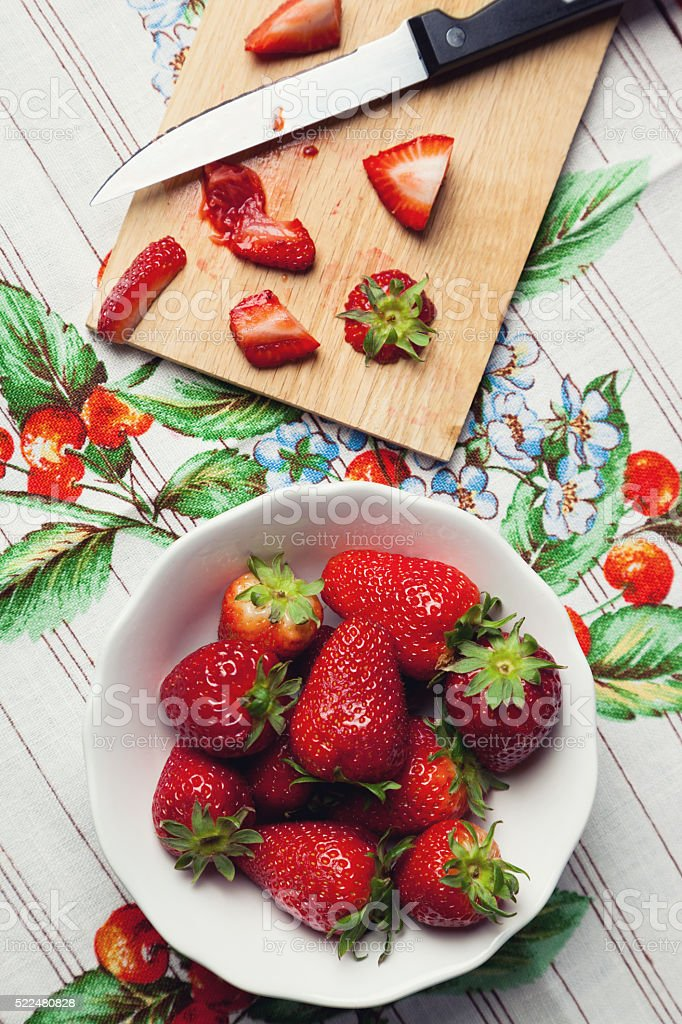 fresh strawberries on the tablecloth stock photo