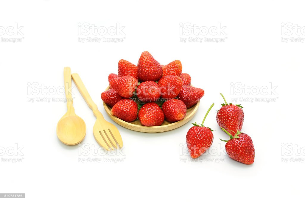 Fresh strawberry and wooden spoon on white background stock photo