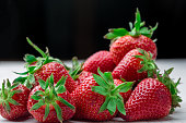 Fresh strawberry background. Ripe  in close-up.